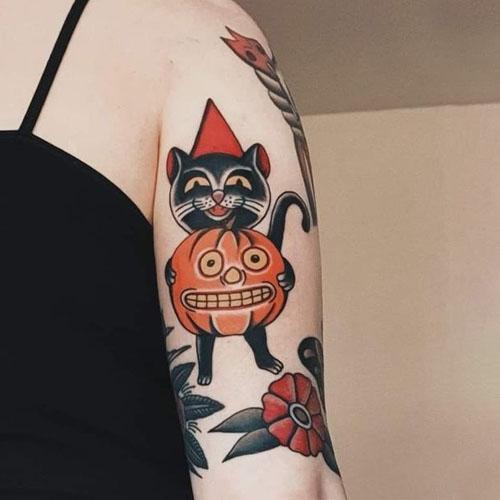 Cat Carrying A Pumpkin